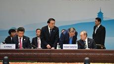 Владимир Путин на первом рабочем заседании глав делегаций государств-участников Группы двадцати
