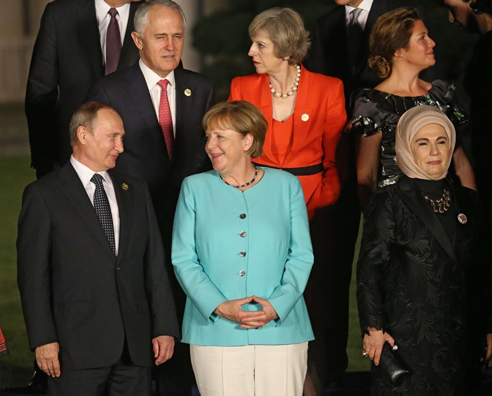 Russian President Vladimir Putin and German Chancellor Angela Merkel at a joint photo of heads of delegations of States Parties Twenty G20 Groups