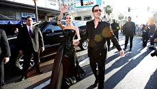 Американские актеры Анджелина Джоли и Брэд Питт. 2014 год