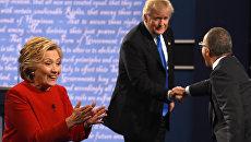 Кандидаты в президенты США Хиллари Клинтон и Дональд Трамп во время дебатов. 26 сентября 2016