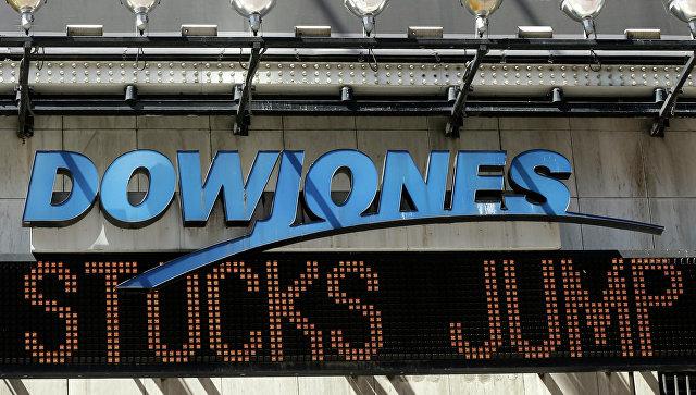 Индикатор Доу Джонса на Таймс-сквер в Нью-Йорке, США. Архивное фото