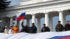 Участники праздничных мероприятий, посвященных годовщине присоединения Крыма к России. Архивное фото