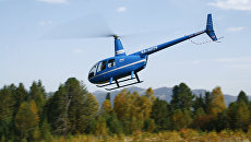 Вертолет Robinson R44. АРхивное фото