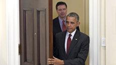 Президент США Барак Обама и директор ФБР США Джеймс Коми. Архивное фото