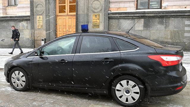 Автомобиль Государственной фельдъегерской службы РФ у здания министерства экономического развития Российской Федерации