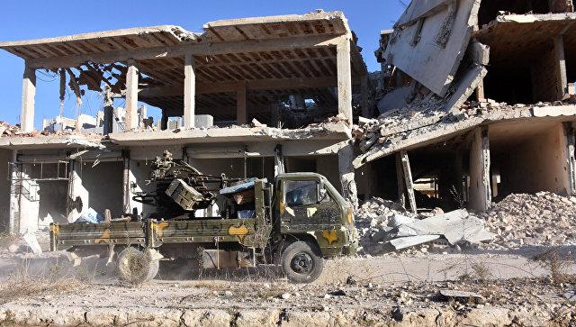Военный автомобиль сирийской армии в восточной части Алеппо. Архивное фото