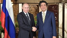 Официальный визит президента РФ Владимира Путина в Японию. 15 декабря 2016. Архивное фото