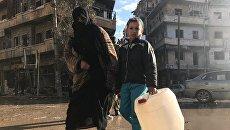 Мирные жители возвращаются в освобожденные кварталы восточного Алеппо