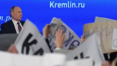Президент РФ Владимир Путин на двенадцатой большой ежегодной пресс-конференции в Центре международной торговли на Красной Пресне. Архивное фото