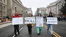 Участники Марша женщин в Вашингтоне. 21 января 2017 год