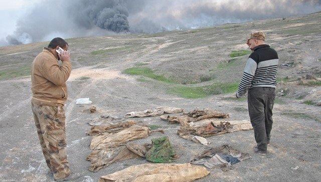Вскрытие братской могилы на юге Мосула