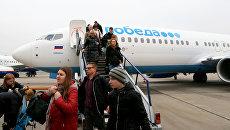 Пассажиры авиакомпании Победа. Архивное фото