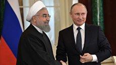 Президент РФ Владимир Путин и президент Исламской Республики Иран Хасан Роухани. Архивное фото