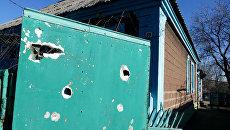 Жилой дом, пострадавший в результате обстрела Ясиноватой в Донецкой области. Март 2017