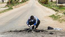 Сбор образцов почвы после химической атаки в городе Хан-Шейхун. Апрель 2017 года