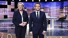 Кандидаты в президенты Франции — основатель движения Вперед Эммануэль Макрон и лидер партии Национальный фронт Марин Ле Пен на теледебатах