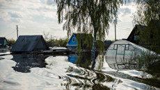 Частные дома, подтопленные в результате сильного поднятия воды в реках. Архивное фото