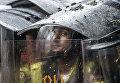 Сотрудники полиции на акциях протеста в Каракасе, Венесуэла