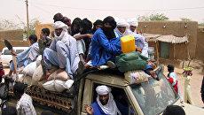 Автомобиль с беженцами в Агадесе, недалеко от границы Ливии и Алжира. Архивное фото