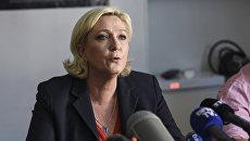 Новоизбранный член парламента Марин Ле Пен на пресс-конференции. 19 июня 2017