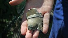 Фрагменты снаряда, найденные на месте минометного артобстрела. Архивное фото