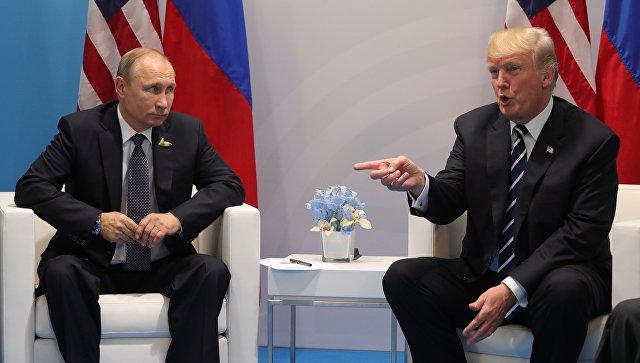 Президент РФ Владимир Путин и президент США Дональд Трамп во время саммита G20 в Гамбурге. 7 июля 2017