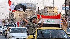 Жители Мосула празднуют освобождение от ДАИШ (запрещена в РФ). Архивное фото