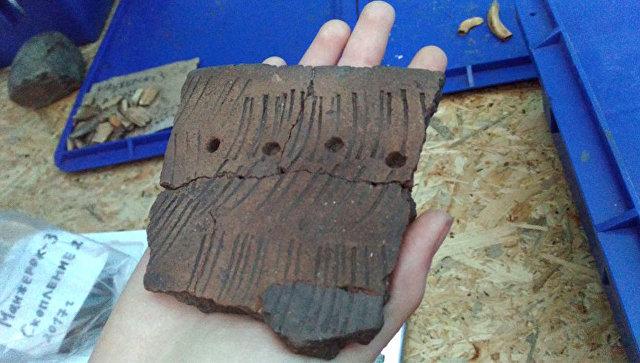 Находки при раскопках древней косторезной мастерской майминцев на Алтае