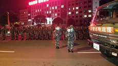Китайская полиция в юго-западной провинции Сычуань. 8 августа 2017