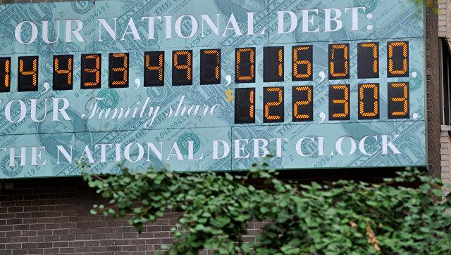 Счетчик государственного долга США на Таймс-сквер в Нью-Йорке. Архивное фото