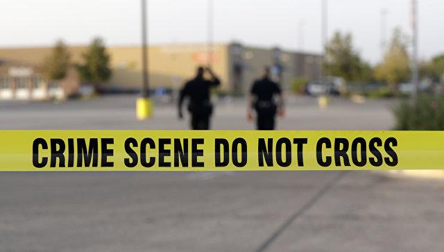 Сотрудники правоохранительных органов США на месте преступления. Архивное фото