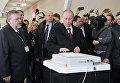 Кандидат в президенты РФ, председатель правительства России Владимир Путин опускает бюллетень в урну для голосования на избирательном участке № 2079 на выборах президента РФ в Российской академии наук. 2012 год