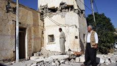 Поврежденное здание после землетрясения в городе Дарбандихан, Ирак. 13 ноября 2017