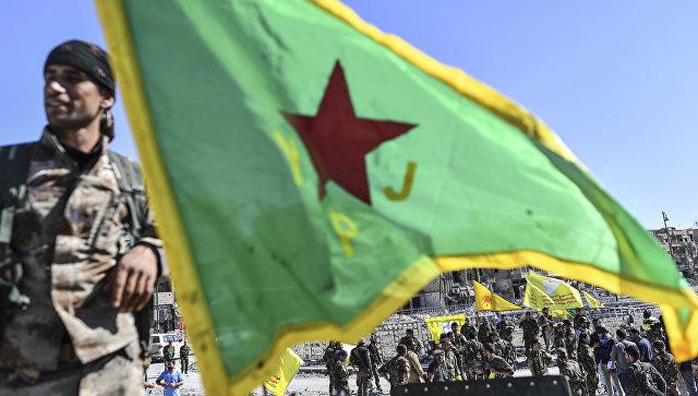 Бойцы отряда народной самообороны курдов (YPG) в городе Ракка, Сирия. Архивное фото