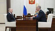 Президент РФ Владимир Путин и генеральный директор Российского фонда прямых инвестиций Кирилл Дмитриев во время встречи. 5 декабря 2017