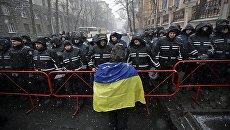 Участник акции протеста в Киеве, Украина. 10 декабря 2017