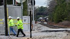 На месте столкновения пассажирского поезда компании Amtrak с грузовым железнодорожным составом в штате Южная Каролина, США. 4 февраля 2018