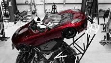 Манекен «Starman» за рулем автомобиля Tesla Roadster, который был запущен в космос при помощи ракеты Falcon Heavy из Космического центра им. Кеннеди на мысе Канаверал. Архивное фото