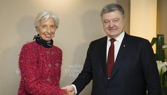 Директор-распорядитель МВФ Кристин Лагард и президент Украины Петр Порошенко на Всемирном экономическом форуме в Давосе. 25 января 2018 года