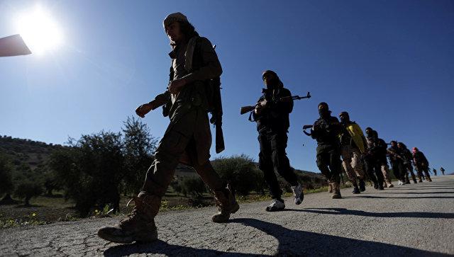Бойцы поддерживаемой Турцией Свободной армии Сирии к северу от Африна, Сирия. 17 марта 2018