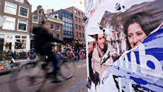 Предвыборный плакат на улице Амстердама в Нидерландах. 21 марта 2018