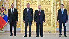 Владимир Путин и чрезвычайный и полномочный посол Австрийской Республики Йоханнес Айгнер на церемонии вручения верительных грамот. 11 апреля 2018