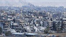 Разрушенные дома в пригороде Дамаска у лагеря палестинских беженцев Ярмук. Архивное фото