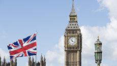 Флаг Великобритании на фоне Вестминстерского дворца. Архивное фото