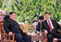 Встреча лидера КНДР Ким Чен Ына с президентом Китая Си Цзиньпином в городе  Далянь, Китай