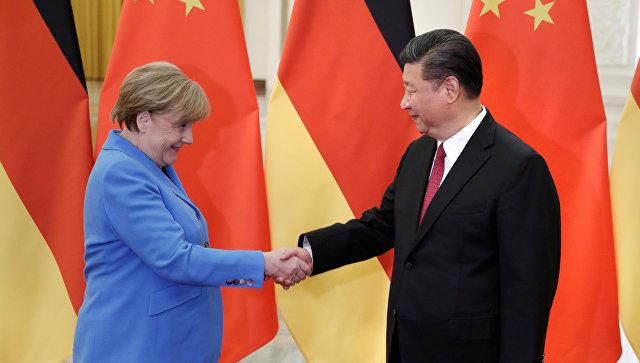 Канцлер ФРГ Ангела Меркель и председатель КНР Си Цзиньпин на встрече в Пекине. 24 мая 2018
