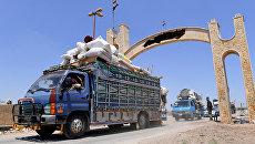 Местные жители возвращаются в свои дома в Сирии. Архивное фото