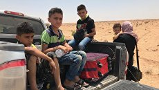 Сирийская семья на границе с Иорданией в провинции Дераа
