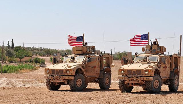 Американские военнослужащие в районе населенного пункта Манбидж, Сирия. Архивное фото