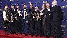 Команда из Игры престолов, победившая в премии Creative Arts Emmy Awards за визуальные эффекты для эпизода За стеной. 8 сентября 2018